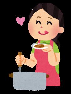お料理をしている女性の画像