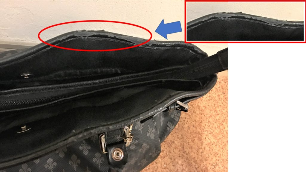 A picture of the tattered faux leather part of the bag