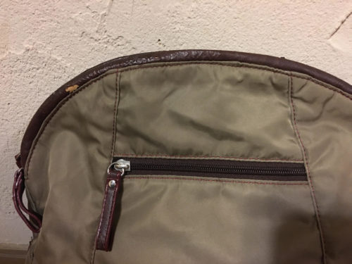 An enlarged image of the faux leather part to be repaired.