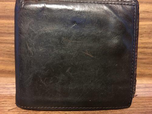 COACHの補修前の財布外側の片側